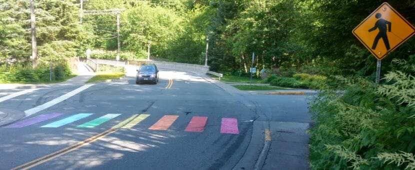 A crosswalk on Calhoun Avenue at the entrance to Juneau's Cope Park was painted in rainbow colors early Tuesday, June 19, 2018. By mid-afternoon city crews had repainted the crosswalk white. (Photo by Jacob Resneck/KTOO)
