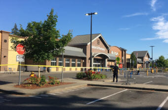 Police block the scene outside a Walmart in Tumwater where a gunman shot a driver, then was himself shot to death on Sunday afternoon. (Photo by Austin Jenkins/Northwest News Network)