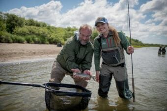 Byron Singley and Abbey Whitcomb pose with their fourth fish caught on the final day of the Bristol Bay Fly Fishing and Guide Academy. (Photo by Sarah Miller)