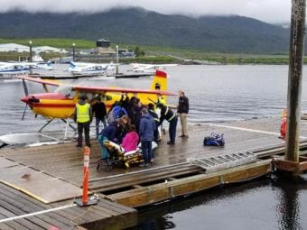 Emergency personnel help survivors of a floatplane crash at the Taquan dock in Ketchikan on June 1, 2018. A floatplane operated by Ketchikan-based RdM with seven people aboard had crashed on Prince of Wales Island.