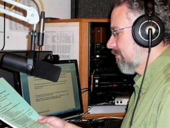 Ed Schoenfeld reads the news at KRBD in Ketchikan. After almost 19 years in print at the Juneau Empire, joining CoastAlaska was a homecoming: Schoenfeld had worked in radio in college, and at KINY and KTOO in Juneau in his early career.