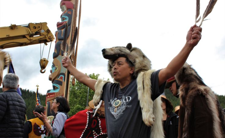 A member of the Yanyeidí clan dances to celebrate the raising of the Gooch (wolf) totem pole at Savikko Park. June 6, 2018. (Photo by Adelyn Baxter/KTOO)