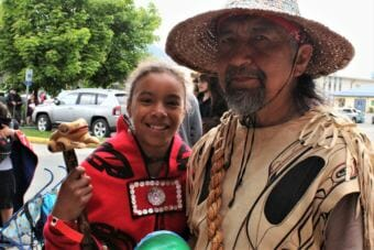 Owen James poses with his daughter Leah Moss. James and Moss both came to Celebration 2018 from Hoonah. (Photo by Adelyn Baxter/KTOO)