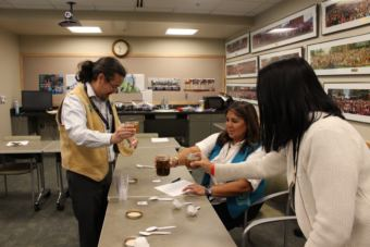 The judges get done scoring the seal oil with crackling. (Photo by Elizabeth Jenkins/Alaska's Energy Desk)