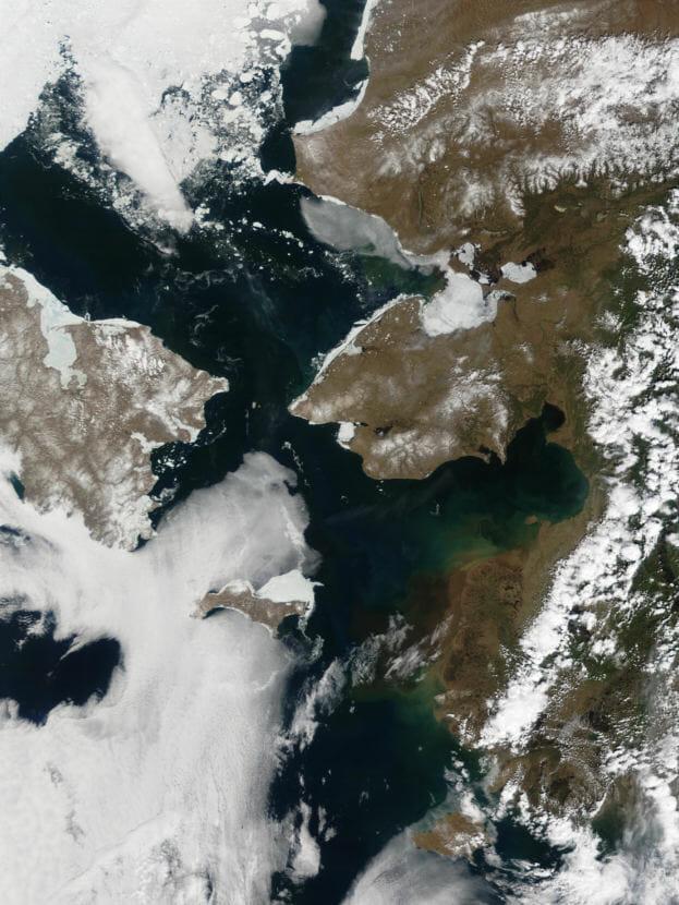 The Bering Strait separates Alaska's Seward Peninsula, right, from Siberia, left, in this June 3, 2002 satellite image.