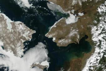 The Bering Strait separates Alaska's Seward Peninsula, right, from Siberia, left, in this June 3, 2002, satellite image.