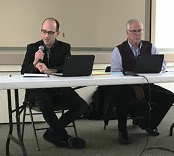 Ketchikan School Board President Trevor Shaw speaks during a school board meeting in Saxman. Also pictured is Superintendent Robert Boyle. (File photo by Leila Kheiry/KRBD)