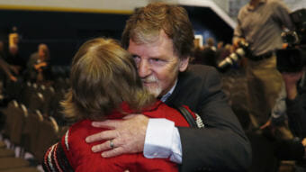 Jack Phillips, owner of Masterpiece Cake, is hugged by a supporter after a rally on the campus of a Christian college in November. (Photo by David Zalubowski/Associated Press)