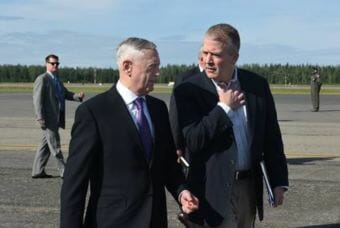 Secretary of Defense James N. Mattis speaks with Alaska Senator Dan Sullivan on June 25, 2018 on the Eielson Air Force Base, Alaska, flight line. Mattis and Sullivan held a joint press conference after a visit to Fort Greely, Alaska. (Photo by Airman 1st Class Eric M. Fisher/U.S. Air Force)