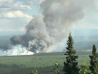 The smoke plume of the Livingston Fire approximately 15 miles southwest of Fairbanks in the Rosie Creek area as seen from Mile 339 of the Parks Highway early Sunday evening, July 8, 2018.