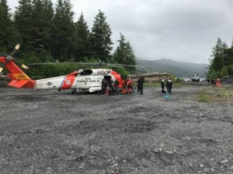 A Coast Guard Air Station Sitka MH-60 Jayhawk helicopter aircrew and Ketchikan Volunteer Rescue Squad personnel tend to survivors from a downed aircraft on Mount Jumbo on Prince of Wales Island, Alaska, July 10, 2018. All 11 people aboard the aircraft survived and were hoisted by a Jayhawk helicopter aircrew and taken to emergency medical personnel for triage before being further taken to Ketchikan for higher level medical care. (Photo courtesy U.S. Coast Guard photo)