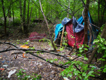 A small camp in the woods near the Chester Creek Trail (Photo by Zachariah Hughes/Alaska Public Media)