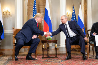 U.S. President Donald Trump and Russian President Vladimir Putin shake hands in Helsinki on July 16, 2018.