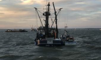 The fishing vessel Pacific Knight takes a sockeye delivery in the summer of 2018. It capsized with three people aboard in Bristol Bay on July 25, 2018.