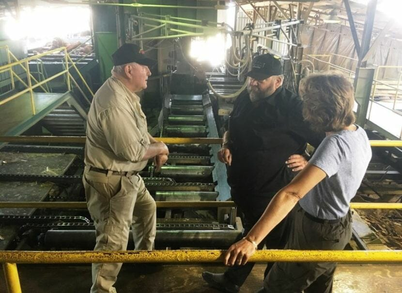 Secretary of Agriculture Sonny Perdue, left, and U.S. Sen. Lisa Murkowski talk July 5 with Kirk Dahlstrom at the Viking Lumber mill in Klawock. The mill is the largest private employer on Prince of Wales Island. (Photo by Leila Kheiry/KRBD)