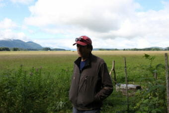Frank Rue stands in his backyard. The Mendenhall Wetlands State Game Refuge was established in 1976. (Photo by Elizabeth Jenkins/Alaska's Energy Desk)
