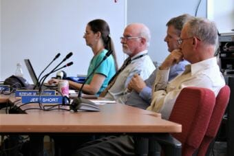 Juneau School District Superintendent Mark Miller looks on as board members deliberate over his contract on Friday, July 27, 2018. (Photo by Adelyn Baxter/KTOO)