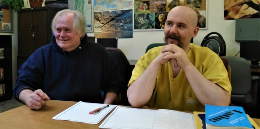Jim Hale and Lowell Ford sit in the library at Lemon Creek Correctional Center after Latin class on June 11, 2018.