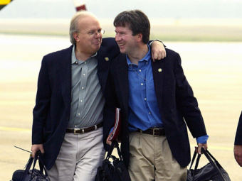Presidential adviser Karl Rove, left, with Brett Kavanaugh in 2004. Kavanaugh was staff secretary in the White House at the time. (Photo by Paul J. Richards/AFP/Getty Images)