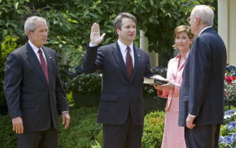 Brett Kavanaugh is sworn in as a federal judge by Supreme Court Justice Anthony Kennedy in 2006. President George W. Bush looks on. Kavanaugh is Trump's pick to replace Kennedy on the Supreme Court. (Photo by Paul J. Richards/AFP/Getty Images)