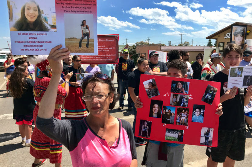 Loxie Loring walks with a group of marchers to remember her daughter, Ashley Loring, who went missing from the Blackfeet Reservation more than a year ago. (Photo by Nate Hegyi/Yellowstone Public Radio)