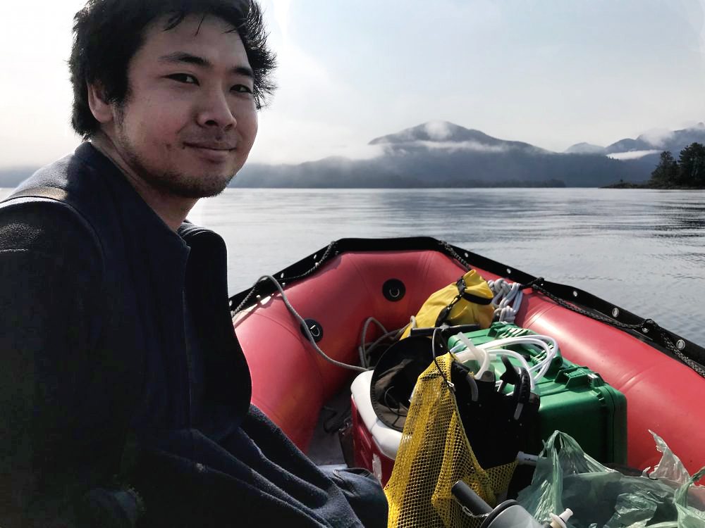 Researcher Umi Hoshijima, heading to the kelp forest he's studying. (Photo by Rachel Cassandra/KCAW)