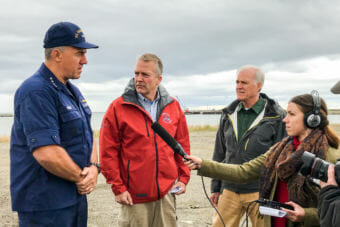 U.S. Coast Guard Commandant Karl Schultz, U.S. Sen. Dan Sullivan, and Secretary of the Navy Richard Spencer talked to reporters from the beach near the Nome Port. Photos by Margaret DeMaioribus/KNOM.