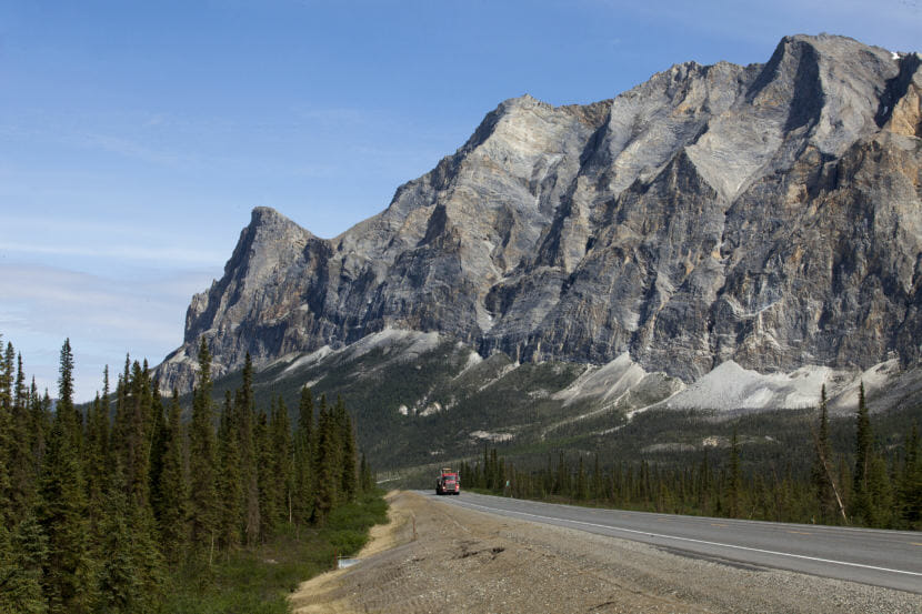 A truck makes its way south on the Dalton Highway near Coldfoot, Alaska. (Photo by Rashah McChesney/Alaska's Energy Desk)