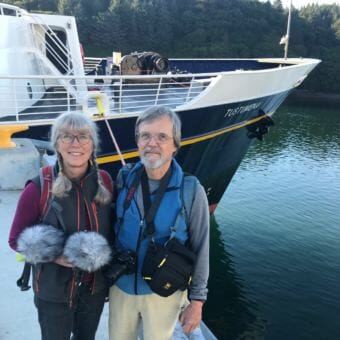 Documentarians Lucy Peckham and Michael Sakarias, pictured here in front of the Alaska Marine Highway System's ferry Tustumena in Kodiak on Wednesday, Aug. 22, 2018, are collecting stories about the ship.