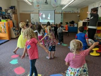 "Children practice the ""brain dance"" at Kindergarten Boot Camp at Harborview Elementary School in summer 2018."
