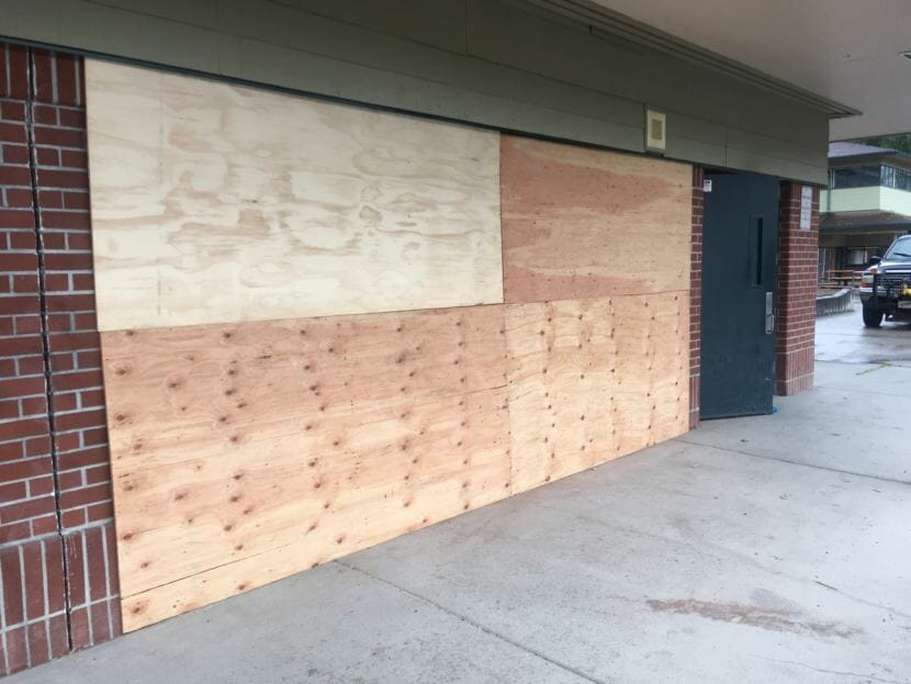 A portion of Dzantik'i Heeni Middle School is boarded up Friday, Aug. 3, 2018, after a Jeep crashed into the school earlier in the week. (Photo by Matt Miller/KTOO)