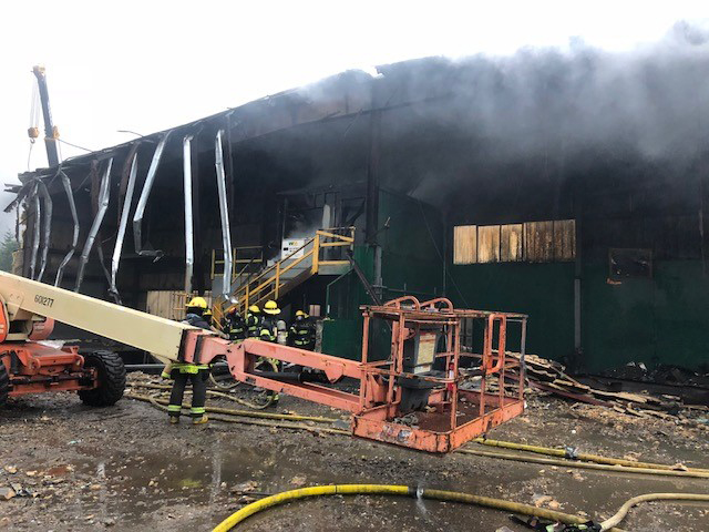 Capital City Fire/Rescue personnel fight a fire early Thursday at the former recycling center at the Juneau landfill. (Photo courtesy Fire Marshal Daniel Jager)