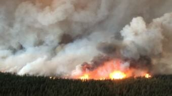 The South Stikine River fire just east of Telegraph Creek, B.C. has grown to around 60 square kilometres in size. The B.C. Wildfire Service said it was burning 'aggressively' on Monday and jumped the Stikine River. (Photo courtesy British Columbia Wildfire Service)