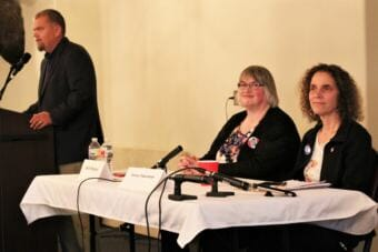 Juneau Chamber of Commerce President-elect Mike Satre introduces mayoral candidates Beth Weldon, left, and Saralyn Tabachnick, right, at a candidate forum on Sept. 27, 2018. Norton Gregory joined by phone. (Photo by Adelyn Baxter/KTOO)