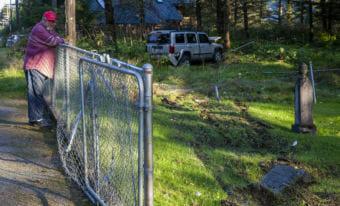 Merill Sanford surveys the damage at his family's cemetery after a jeep drove through it on Thursday, September 6, 2018, on Douglas Island, Alaska. (Photo by Rashah McChesney/Alaska's Energy Desk)
