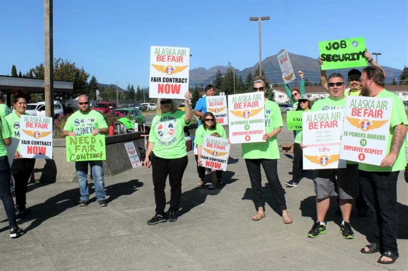 Alaska Airline employees and supporters picket outside Juneau International Airport Monday, Sept. 10, 2018 over slow-moving contract negotiations with the airline. (Photo by Adelyn Baxter/KTOO)