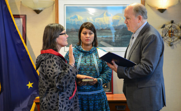 Valerie Nurr'araaluk Davidson is sworn as lieutenant governor during a ceremony with Director of Rural and Native Affairs Barbara Blake and Gov. Bill Walker in Anchorage on Tuesday, Oct. 16, 2018.