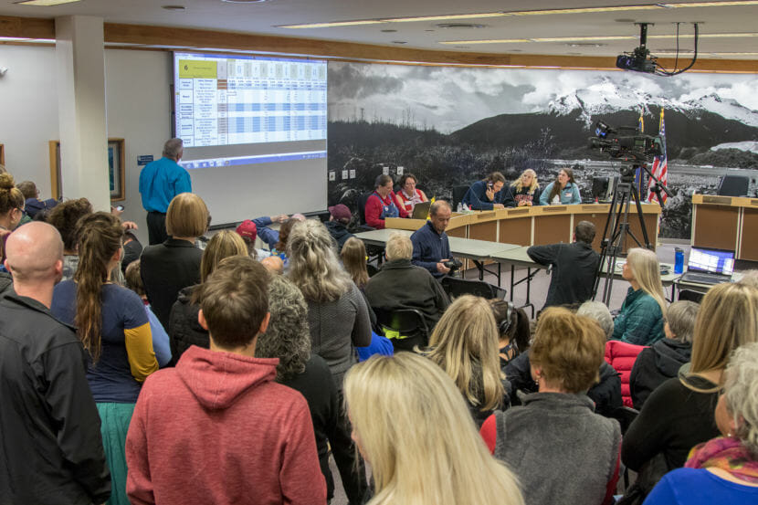 People watch election Juneau municipal returns come in at city hall on election night, Oct. 2.