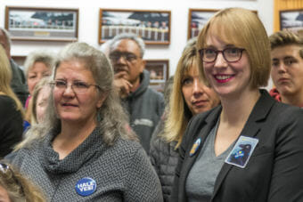 Juneau Assembly candidates Michelle Bonnet Hale, left, and Carole Triem watch election returns on Tuesday, Oct. 2, 2018, at City Hall. (Photo by Mikko Wilson/KTOO)