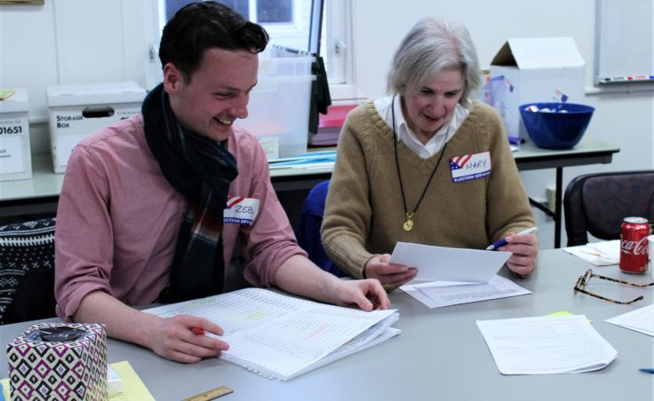 Canvass Review Board members Zebadiah Bodine and Mary Foster verify absentee ballots from the Oct. 2 election on Oct. 5, 2018. (Photo by Adelyn Baxter/KTOO)