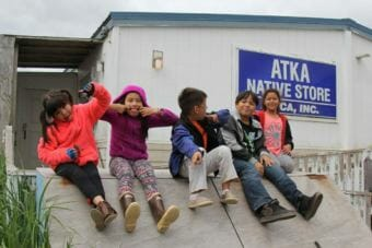 Kids play outside Atka's general store.