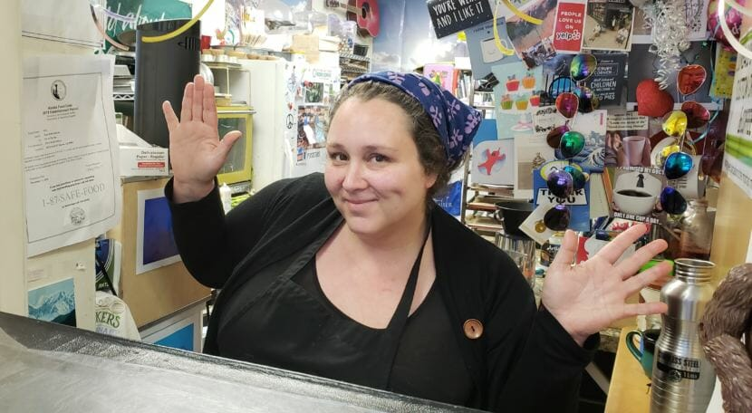 Jeste Burton posts for a photo in her shop, Pie in the Sky, in downtown Juneau on Oct. 11, 2018.