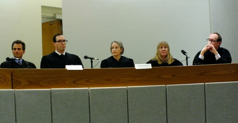 Superior Court Judge Amy Gurton Mead (center) listens to other judges during her installation and robing ceremony Oct. 26, 2018 at the Dimond Courthouse. Sitting from far left, Senior Judge Keith Levy, Ketchikan District Court Judge Kevin Miller, Juneau District Court Judge Kirsten Swanson, and Sitka Superior Court Judge Jude Pate.