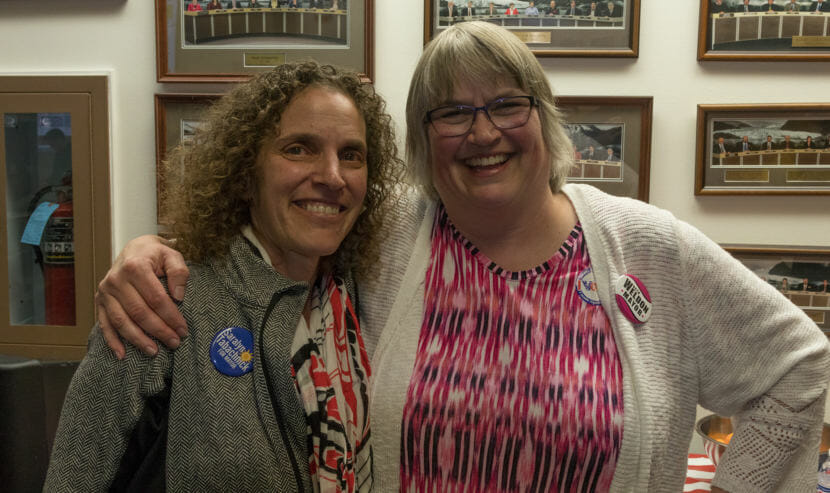 Juneau mayoral candidates Saralyn Tabachnick, left, and Beth Weldon pose after Weldon's apparent election night victory on Tuesday, Oct. 2, 2018, at City Hall.