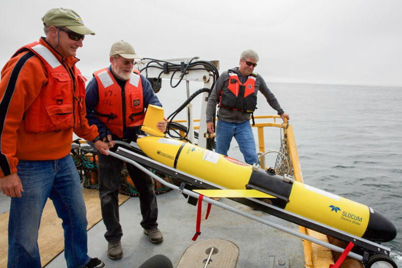 "Oregon State University oceanographer Jack Barth deploys a glider that will spend weeks at sea collecting data on everything from dissolved oxygen levels to temperature. ""When we used to think about hypoxia in the ocean, we think about little areas. But now what we're looking at is...out in the ocean, there's low oxygen...all along the coast,"" he says. (Photo by Kristian Foden-Vencil/NPR)"