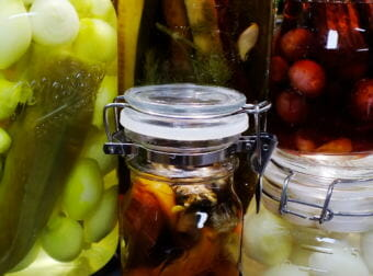 Homegrown onions, cucumbers, peppers, and mushrooms get pickled in a North Douglas kitchen.