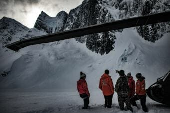 Members of Juneau Mountain Rescue and partner organizations stand on the Juneau Icefield looking up at the Mendenhall Towers. (Photo by Mike Janes)
