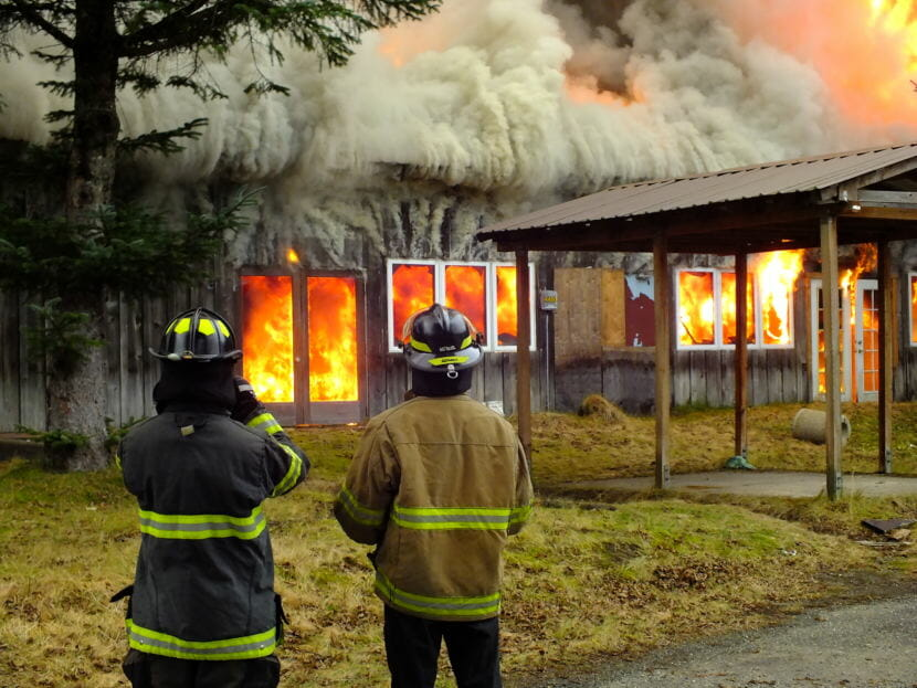 Capital City Fire/Rescue firefighters watch the Thane Ore House controlled burn on Nov. 24, 2018.