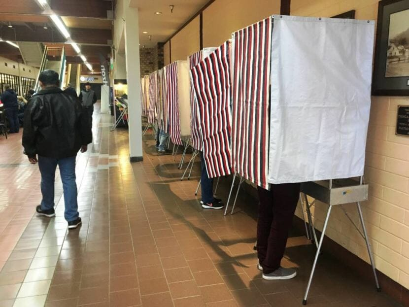 Voters mark their ballots at Ketchikan's Precinct No. 2 at The Plaza on Nov. 6, 2018.