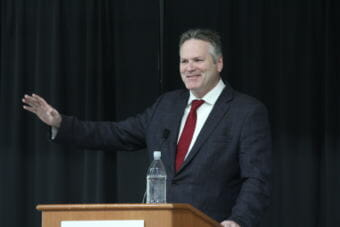 Gov.-elect Mike Dunleavy speaks to the Alaska Miners Association about his plans for his administration. He named Tuckerman Babcock to be his chief of staff and transition chairman. (Photo by Wesley Early/Alaska Public Media)